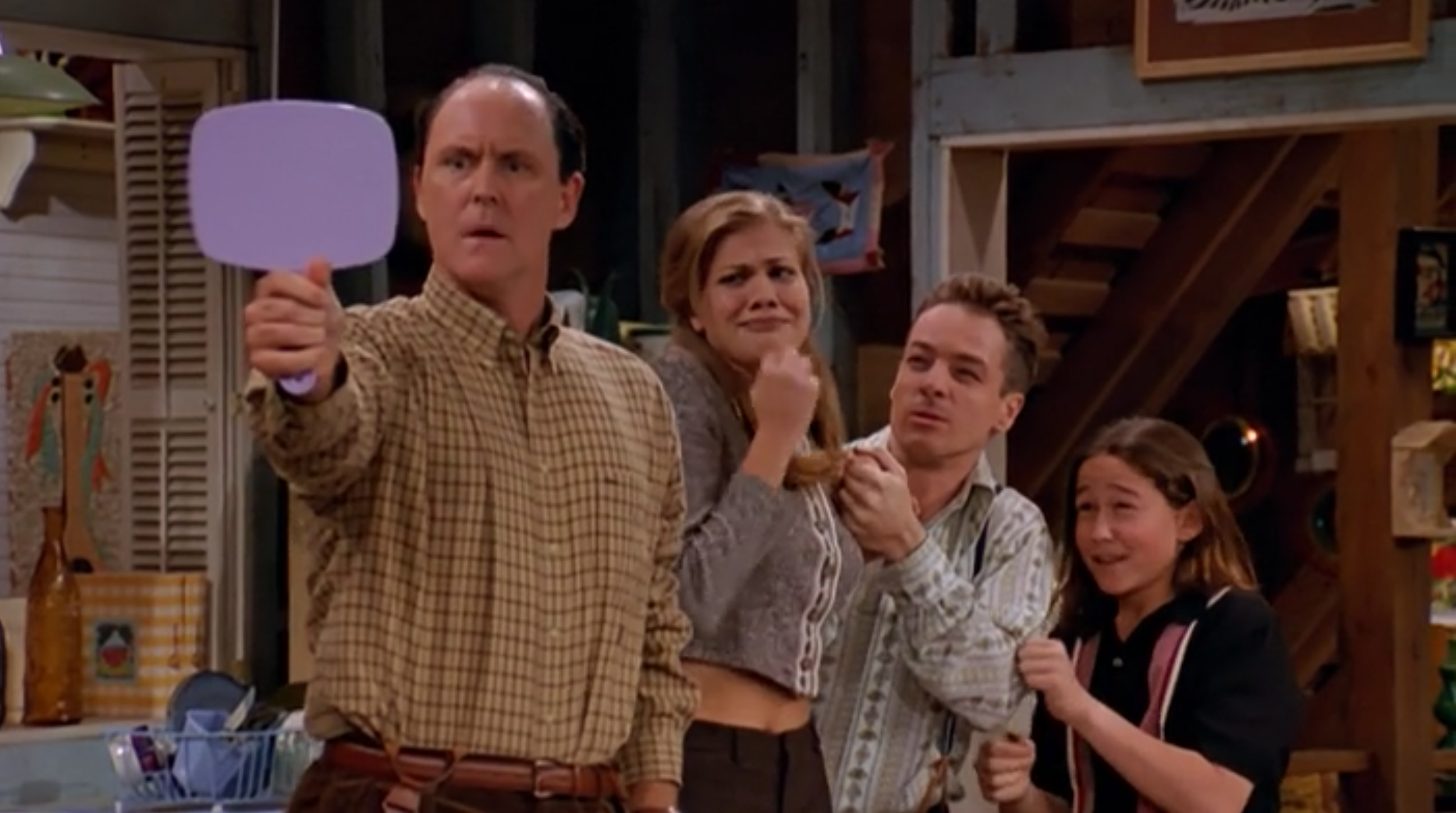 John Lithgow as Dick, surrounded by his alien