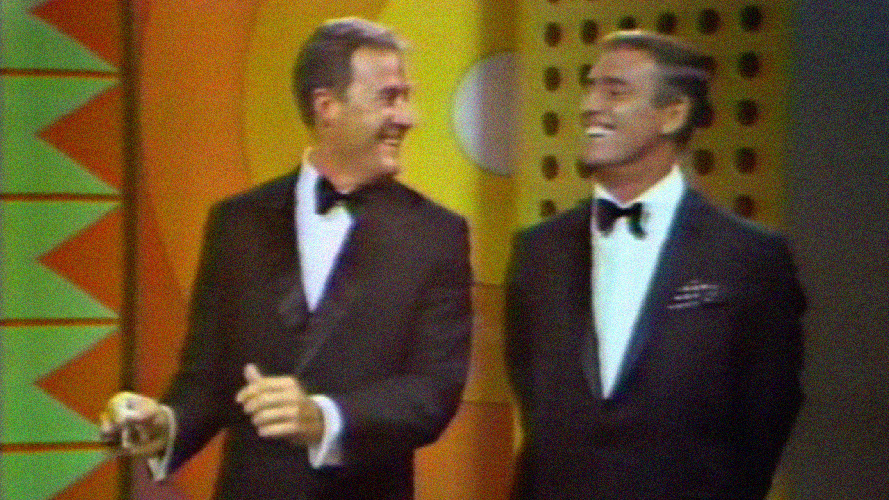 Dan Rowan and Dick Martin host the Laugh-in comedy variety show.